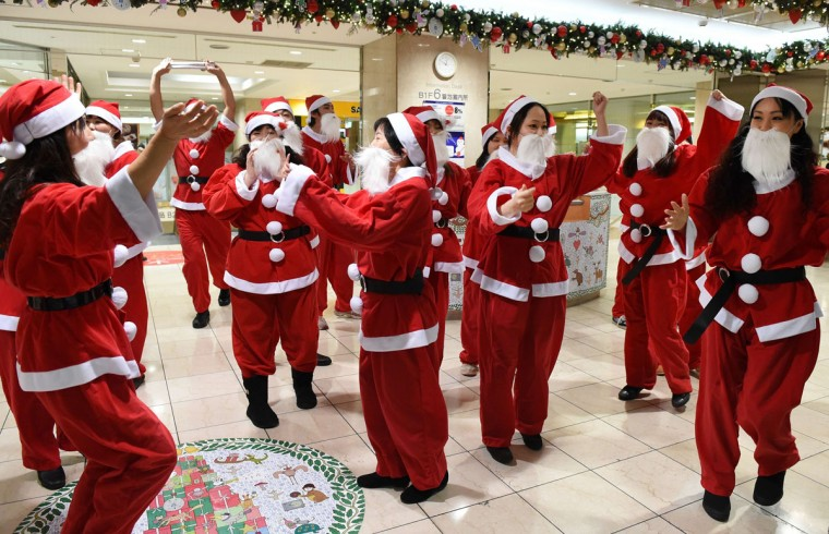 Dancers clad in Santa Claus outfits perform as part of a flash mob event to entertain Christmas shoppers at Tobu Department Store in Tokyo on December 19, 2014. Some 30 dancers took part in the event. (Toru Yamanaka/AFP/Getty Images)