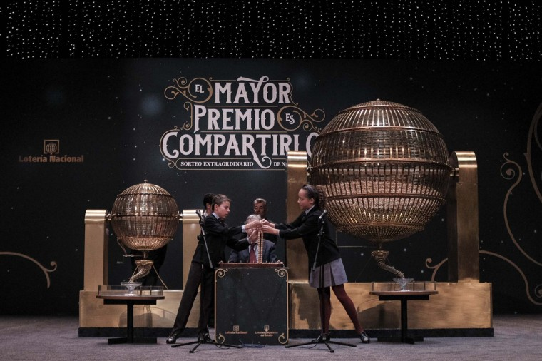 """Pupils from San Ildefonso school collate numbers during the draw of Spain's Christmas lottery named """"El Gordo"""" (Fat One) in Madrid, on December 22, 2014. (Pedro Armestre/AFP/Getty Images)"""