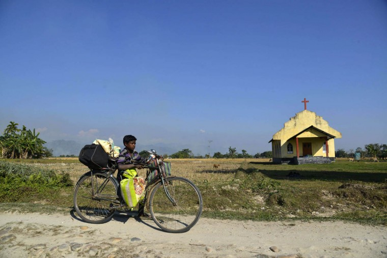 A young Indian villager uses a cycle to carry his belongings while fleeing from the village of Tenganala in Sonitpur District after relatives were killed by militants. Violence in the restive Indian state of Assam has killed 68 people including 12 children, authorities said, as separatist rebels dramatically intensified a long-running campaign in the tea-growing area. Heavily armed militants launched a series of coordinated attacks in rural Assam late December 22, pulling villagers from their homes and shooting them at point-blank range, witnesses said. (Strdel/Getty Images)