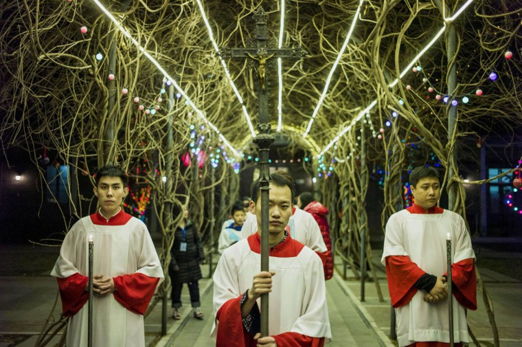 Young Chinese worshippers attend the Christmas Eve mass at a Catholic church in Beijing as Christians around the world prepare to celebrate the holy day. (Fred Dufour/Getty Images)