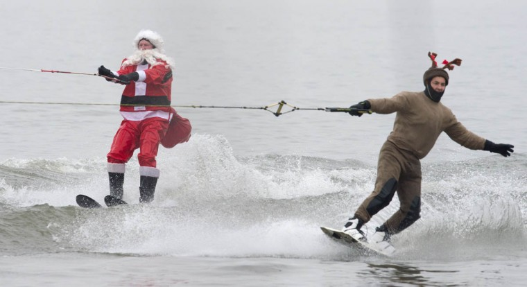 The water-skiing Santa and a Reindeer are seen along the Potomac River off Old Town Alexandria, Virginia, not far from Washington, DC. during the annual water-skiing Santa event. (Paul J. Richards/Getty Images)