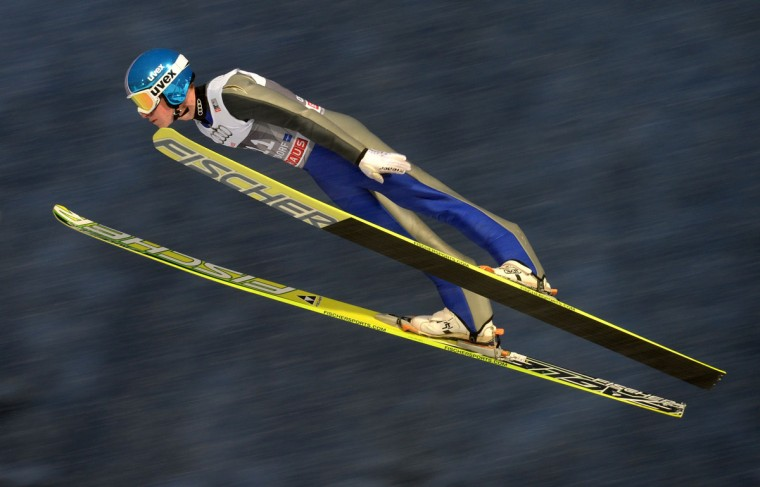 Polish Kamil Stoch competes during a training session ahead of the Four-Hills Ski jumping tournament (Vierschanzentournee) in Oberstdorf, southern Germany on December 29, 2014. Austrian Stefan Kraft won the competition, his teammate Austrian Michael Hayboeck placed second and Slovenian Peter Prevc placed third. The first competition of the Four-Hills Ski jumping event takes place in Oberstdorf, before the tournament continues in Garmisch-Partenkirchen, (Germany), in Innsbruck (Austria) and in Bischofshofen (Austria). (Christof Stache/AFP/Getty Images)