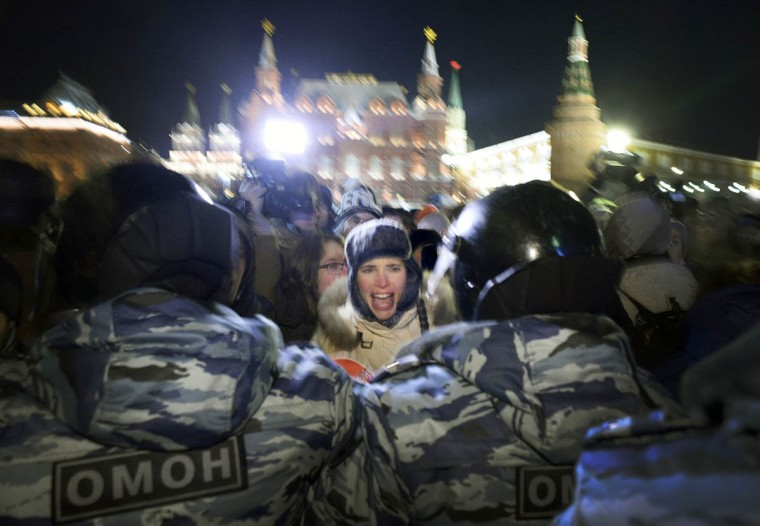 """A woman screams during an unauthorized rally in support of Russian opposition leader Alexei Navalny and his brother Oleg Navalny in central Moscow on December 30, 2014. Russia's top opposition leader Alexei Navalny on December 30, 2014, called for mass protests to """"destroy"""" President Vladimir Putin's regime after a court handed him a suspended sentence and jailed his brother in a controversial fraud case. (Alexander Nemenov/Getty Images)"""