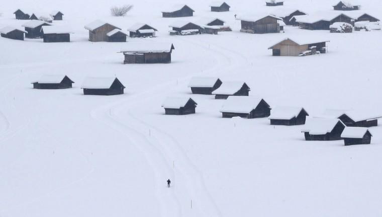 A skier makes his way through the snow-covered landscape in Garmisch-Partenkirchen, Germany, on Wednesday, Dec. 31, 2014. (Matthias Schrader/AP photo)
