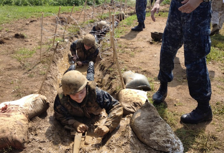 More than 1,000 Naval Academy freshmen slopped through mud, clambered over obstacles and beat each other with padded sticks Tuesday in a rite of passage known as Sea Trials, marking the end of their plebe year. (Algerina Perna/Baltimore Sun)