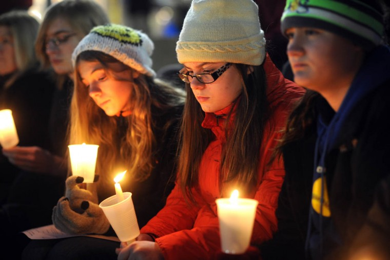 From left, Benjamin thor Straten, almost 17; Ashleigh Jankowski, 13; Katie thor Straten, 13, and Rayner Reinhardt with St. John's United Church of Christ attend the memorial. On the longest night of the year, National Homeless Persons' Memorial Day is commemorated in Baltimore by a memorial service at the Inner Harbor Amphitheatre. One hundred and sixteen people died in Baltimore as a result of homelessness, according to organizations which sponsored the event: Healthcare for the Homeless, Inc.; Baltimoreís Stop Homelessness and Reduce Poverty (SHARP) Coalition, the Coalition for Homeless Children and Families, and the Baltimore Homeless Youth Initiative (BHYI). (Algerina Perna/Baltimore Sun)