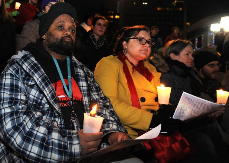 Bottom row from left: Damien Haussling who was formerly homeless and now works for SHARP; Emily Torstveit Ngara, and Meredith Johnston listen to the speakers eulogize homeless men and women who have died. (Algerina Perna/Baltimore Sun)