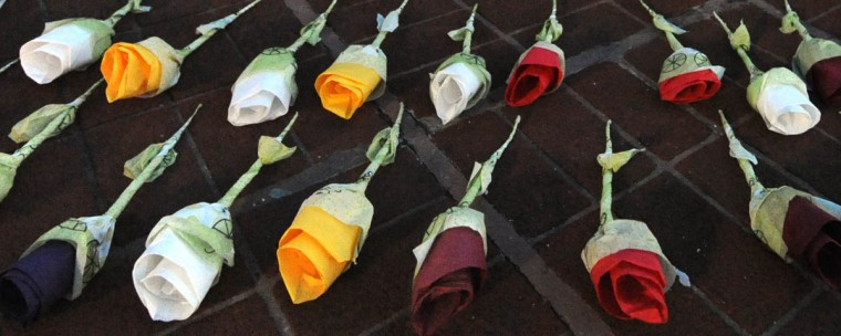 "Victor Bernard, 45, from Baltimore, made the flower memorials saying they were his ""contribution to the fallen homeless that didn't have a chance to have a voice."" Bernard is currently homeless. (Algerina Perna/Baltimore Sun)"