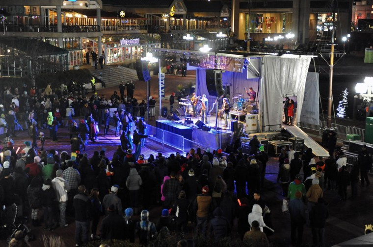 Baltimore's New Year's Eve Spectacular welcomes the new year with music from Baltimore-based band Under The Covers performing at the amphitheater and a fireworks and light show display at midnight over the Inner Harbor. (Kenneth K. Lam/Baltimore Sun)