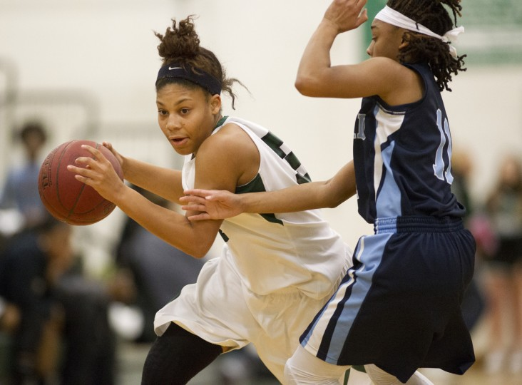 Atholton's Ryan Jones moves the ball during the girls basketball game against Howard at Atholton High School, MD on Wednesday, December 10, 2014. (Jen Rynda/BSMG)