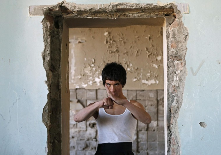 Abbas Alizada, who calls himself the Afghan Bruce Lee, poses during a media event in Kabul December 9, 2014. (Mohammad Ismail/Reuters)