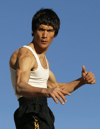 Abbas Alizada, who calls himself the Afghan Bruce Lee, poses for the media in Kabul December 9, 2014. (Mohammad Ismail/Reuters)