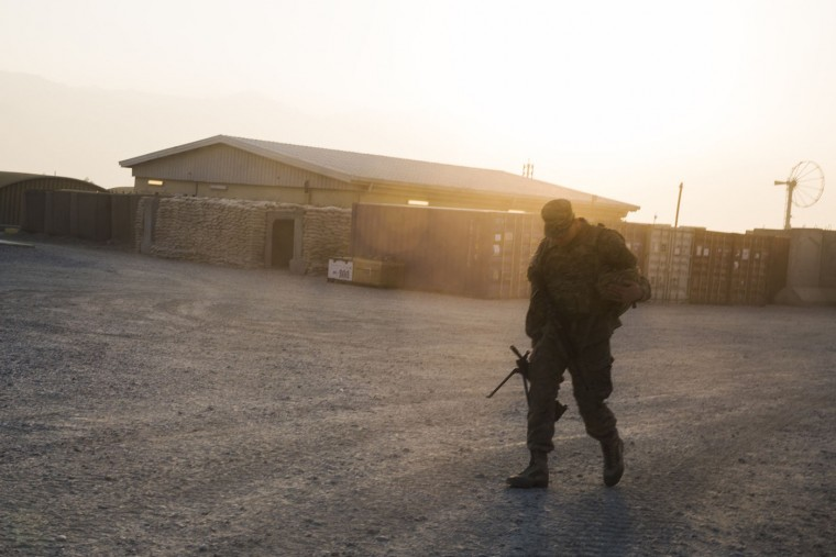 A U.S. soldier from the 3rd Cavalry Regiment walks with his rifle, after returning from a mission at forward operating base Gamberi, in the Laghman province of Afghanistan, December 15, 2014.