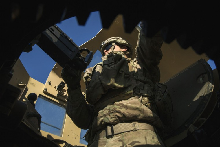A U.S. soldier from the 3rd Cavalry Regiment stands in a turret of a Mine-Resistant Ambush Protected (MRAP) vehicle during a mission near forward operating base Gamberi in the Laghman province of Afghanistan December 14, 2014.