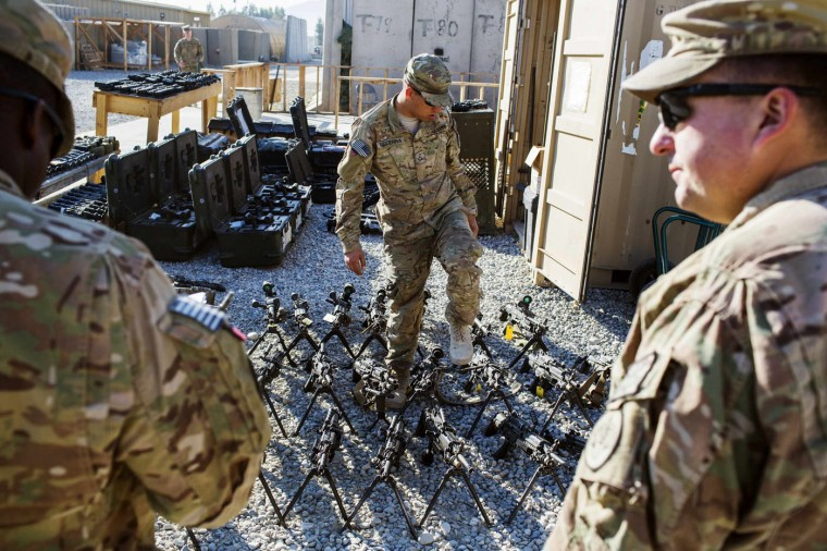 U.S. soldiers from the 3rd Cavalry Regiment take inventory of unused equipment at Forward Operating Base Gamberi which remains part of the ongoing Operation Resolute Support in the Laghman province of Afghanistan December 11, 2014.