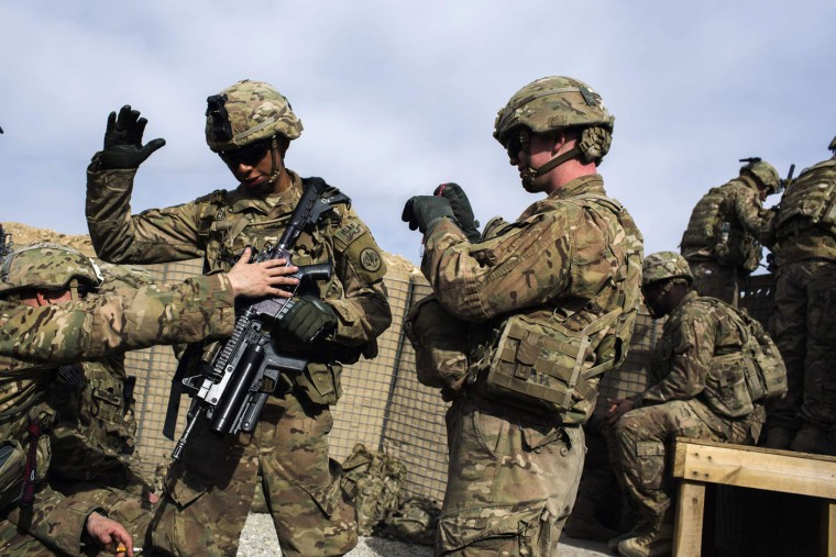 U.S. soldiers from the 3rd Cavalry Regiment wait for helicopters to pick them up after an advising mission at the Afghan National Army headquarters for the 203rd Corps in the Paktia province of Afghanistan December 21, 2014.