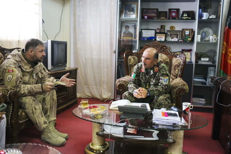 Canadian Army Lt. Col. Christopher Comeau (L), the AAC Southeast Liaison Officer, speaks to Major General Mohammad Sharif Yaftali, the Afghan National Army's 203rd Corps Commander, at his headquarters in the Paktia province of Afghanistan December 21, 2014.
