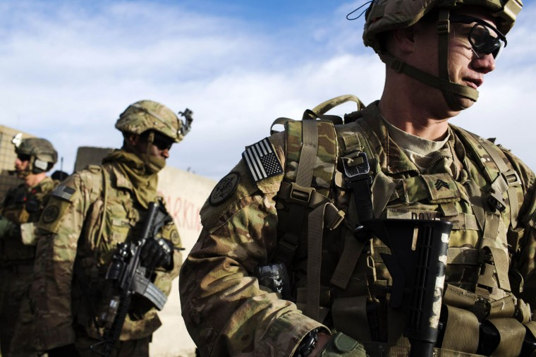 U.S. soldiers from the 3rd Cavalry Regiment prepare for an advising mission at the Afghan National Army headquarters for the 203rd Corps in the Paktia province of Afghanistan December 21, 2014.
