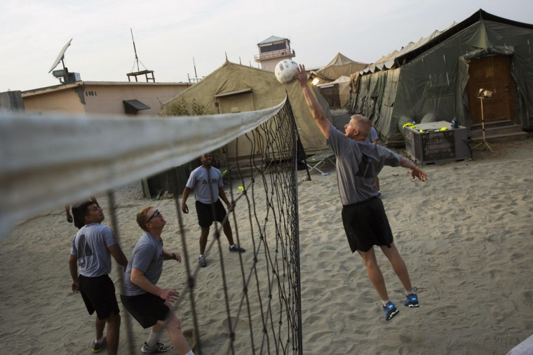 U.S. soldiers play volleyball at forward operating base Fenty in the Nangarhar province of Afghanistan December 21, 2014.