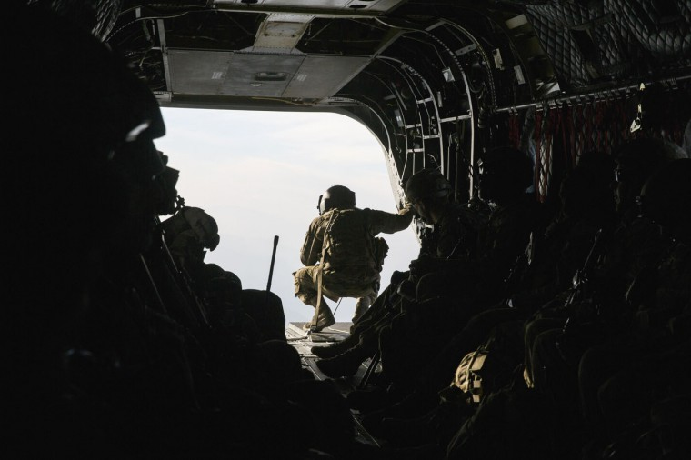 A crew member looks out the window of a CH-47 Chinook helicopter from the 82nd Combat Aviation Brigade as carries U.S. soldiers from the 3rd Cavalry Regiment after an advising mission at the Afghan National Army headquarters for the 203rd Corps in the Paktia province of Afghanistan December 21, 2014.