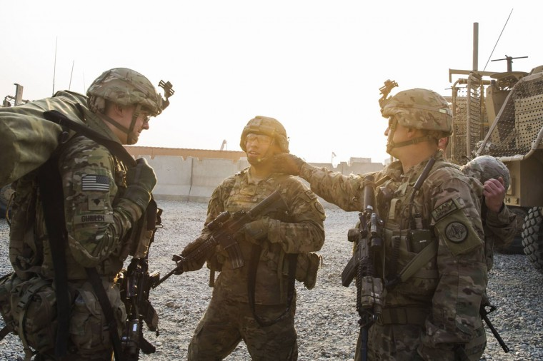 U.S. soldiers from Grim Company of the 3rd Cavalry Regiment laugh as they return from a mission at Forward Operating Base Fenty in the Nangarhar province of Afghanistan December 19, 2014.