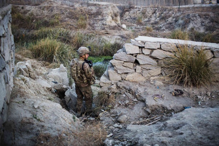 A U.S. soldier from Grim Company of the 3rd Cavalry Regiment stands guard near an Afghan police checkpoint during a mission near Forward Operating Base Fenty in the Nangarhar province of Afghanistan December 19, 2014.