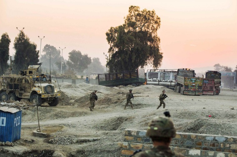 U.S. soldiers from Grim Company of the 3rd Cavalry Regiment walk away from their MRAP vehicles to the street during a mission near Forward Operating Base Fenty in the Nangarhar province of Afghanistan December 19, 2014.