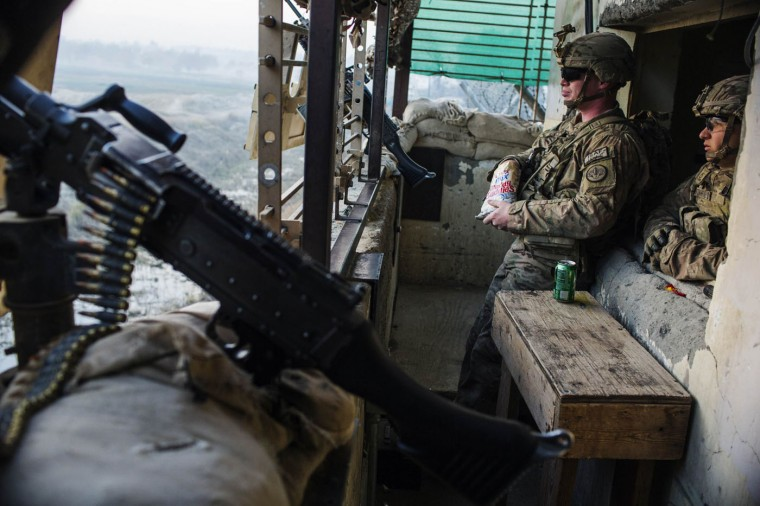U.S. soldiers from the 3rd Cavalry Regiment perform guard duty in a tower on Forward Operating Base Fenty in Nangarhar province December 17, 2014.
