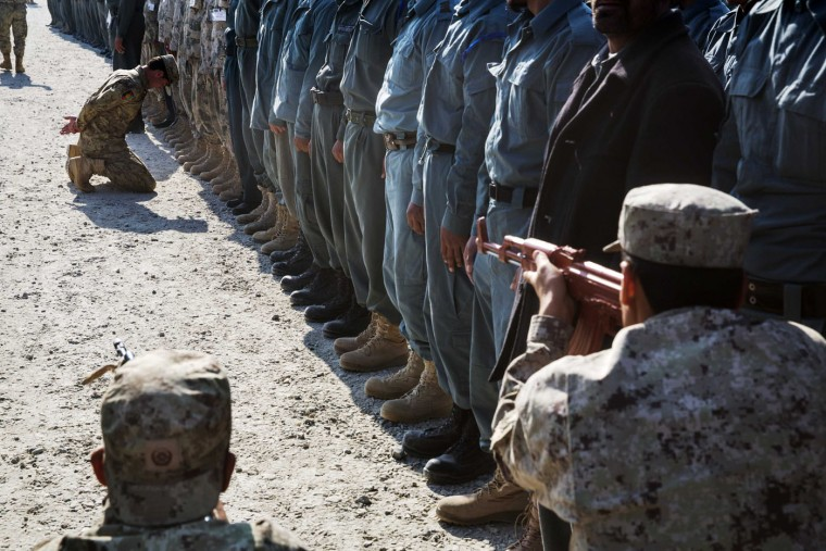 Afghan National police officers demonstrate their training during a visit by U.S. Brigadier General Christopher Bentley to an Afghan National police installation in the Nangarhar province of Afghanistan December 16, 2014.