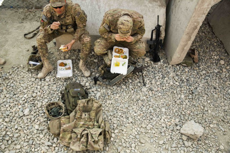 U.S. soldiers from the 3rd Cavalry Regiment eat their lunch from to-go containers before a training mission at forward operating base Gamberi, in the Laghman province of Afghanistan December 15, 2014.