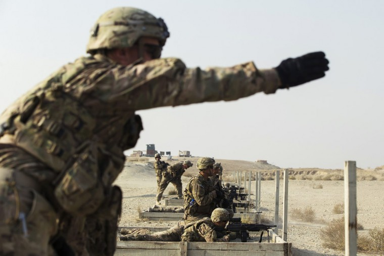 U.S. soldiers from the 3rd Cavalry Regiment fire their squad automatic weapons during a training mission near forward operating base Gamberi, in the Laghman province of Afghanistan December 15, 2014.