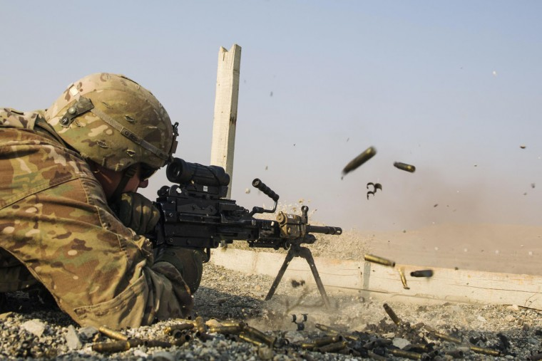 A U.S. soldier from the 3rd Cavalry Regiment is seen as he fires a squad automatic weapon during a training mission near forward operating base Gamberi, in the Laghman province of Afghanistan December 15, 2014.