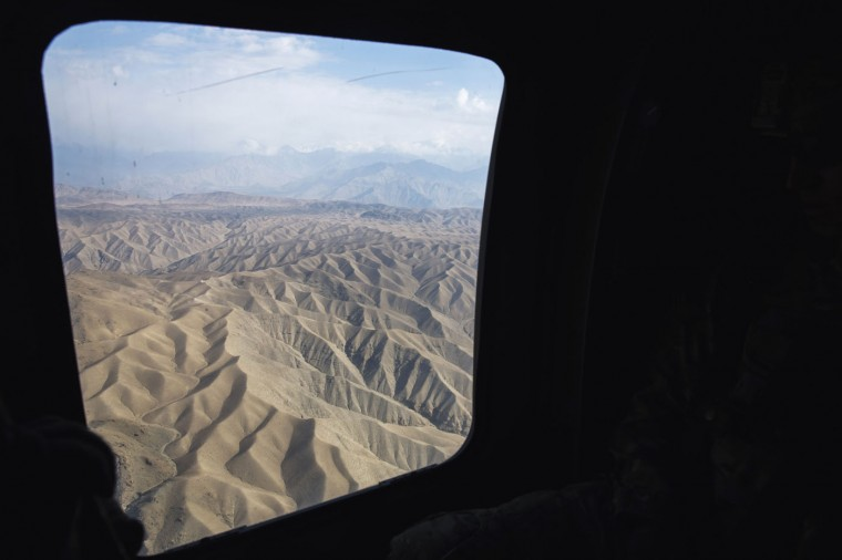 The mountainous terrain of eastern Afghanistan is seen through the window of a UH-60 Blackhawk helicopter near Bagram Air Field in the Parwan province of Afghanistan December 23, 2014.