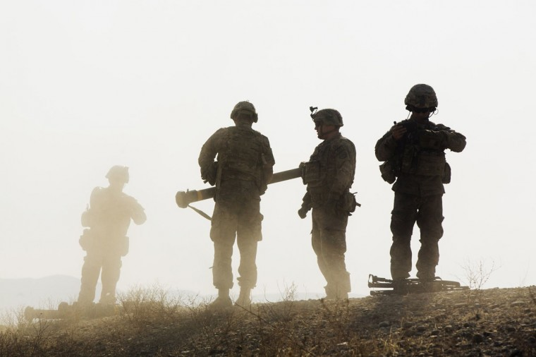 U.S. soldiers from D Troop of the 3rd Cavalry Regiment walk on a hill after finishing with a training exercise near forward operating base Gamberi in the Laghman province of Afghanistan December 30, 2014. (Lucas Jackson/Reuters)