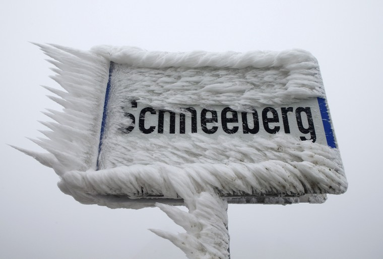 A sign for the village of Schneeberg, translated as Snow Mountain, is covered with ice, in northern Austria, December 3, 2014. Freezing fog and rain has covered parts of the region with ice, causing blocked roads due to fallen trees and closed schools for security reasons, local media report. (Heinz-Peter Bader/Reuters)