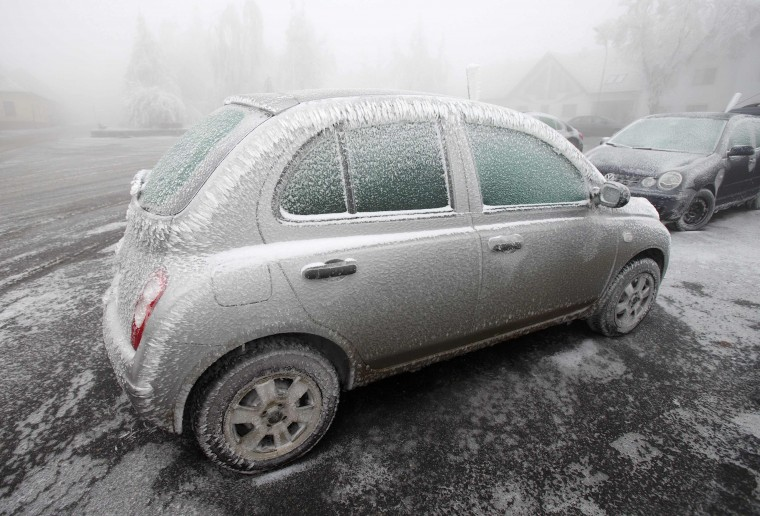 A parked car is covered with ice in Lichtenau in northern Austria, December 3, 2014. Freezing fog and rain has covered parts of the region with ice, causing blocked roads due to fallen trees and closed schools for security reasons, local media report. (Heinz-Peter Bader/Reuters)