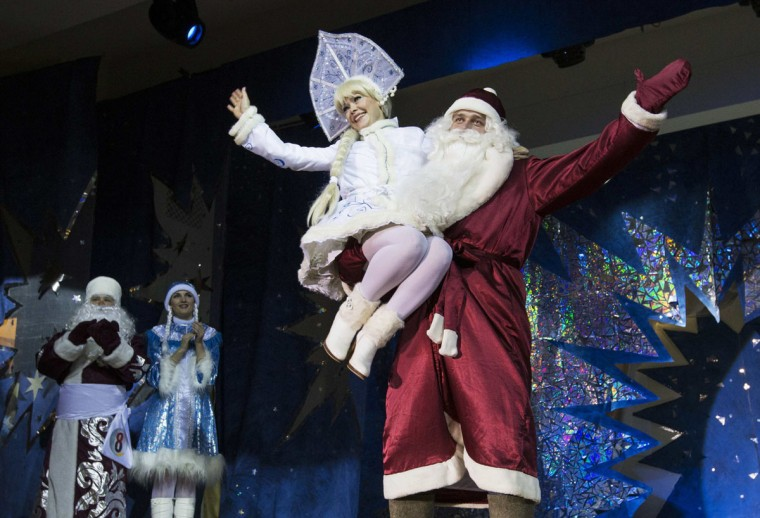 "People dressed as Father Frost, the equivalent of Santa Claus, and Snow Maiden take part in the contest ""Yolka-fest-2014"" (Fir-festival-2014) in Minsk December 12, 2014. (Vasily Fedosenko/Reuters)"