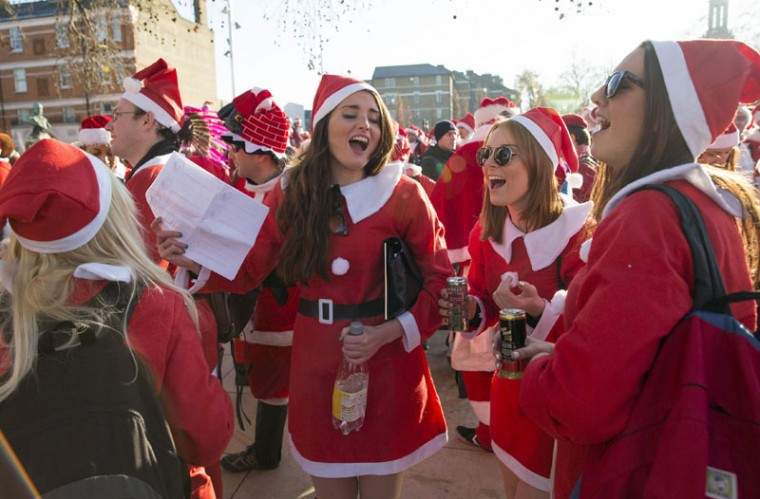 Participants dressed in Santa costumes sing during the annual SantaCon event in London December 6, 2014. (Neil Hall/Reuters)