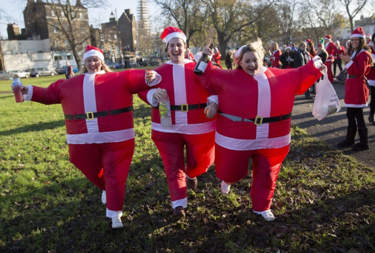 Participants dressed in Santa costumes pose for a photograph during the annual SantaCon event in London December 6, 2014. (Neil Hall/Reuters)