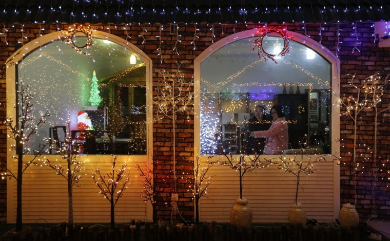 Customers shop at a Christmas lights and decoration store in Taizhou, Zhejiang province, December 10, 2014. Picture taken December 10, 2014. (William Hong/Reuters)