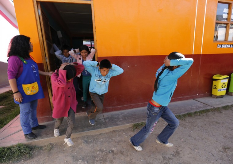 School children evacuate a school during an earthquake and avalanche drill in Ancash. World greenhouse gas emissions are rising fast and it may be years before they start falling, prompting glaciologists to urge Peru to act fast to protect towns and villages in danger. In Lima, nearly 200 governments are meeting this week to thrash out a rough draft of a deal to cut carbon emissions in a bid to ward off more warming. The deal is due to be agreed in Paris in late 2015. (Mariana Bazo/Reuters)