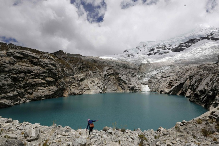 A general view of lake Laguna 513, at more than 13,000 feet above sea level in front of the Hualcan glacier in Huascaran natural reserve in Ancash. Scientists warn that if a giant chunk of ice from the Hualcan glacier breaks off it could trigger a tsunami-like wave in Laguna 513 and send a lethal torrent of water cascading down the valley. In Lima, nearly 200 governments are meeting this week to thrash out a rough draft of a deal to cut carbon emissions in a bid to ward off more warming. The deal is due to be agreed in Paris in late 2015. (Mariana Bazo/Reuters)