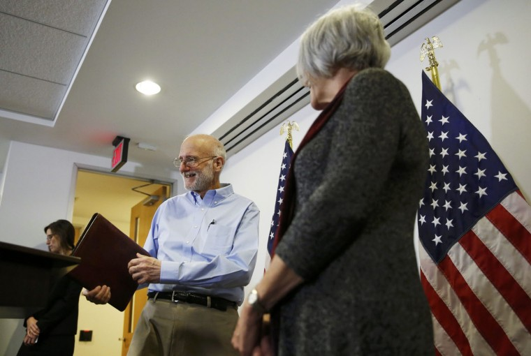 Alan Gross and his wife Judy face a news conference in Washington hours after his release from Cuba on December 17, 2014. Cuba released Gross after five years in prison in a reported prisoner exchange. REUTERS/Gary Cameron