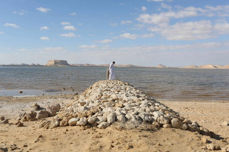 A man stands on a small bridge over the salt lake at a farm near the Salinas of Siwa November 22, 2014. Situated about 17 meters below sea level, Siwa faces problems of salt water flooding the land. Residents of Siwa have been hurt by declining tourism in Egypt, which received 9.5 million tourists last year, down from over 14.7 million tourists in 2010, before the uprising that ousted autocrat Hosni Mubarak. Nationwide, the situation is gradually improving and the government says tourism could recover to pre-crisis levels next year if regional turmoil spares Egypt. But Siwa, located just 50 km (30 miles) from war-torn Libya, still sees only a fraction of the tourists that once visited the desert oasis, the head of Siwa's tourism authority says. (Asmaa Waguih/Reuters)
