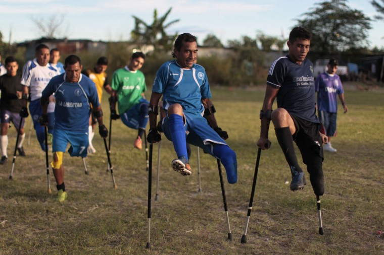 Members of the Salvadorean national amputee soccer team take part in training session at La Estrella soccer field in San Salvador November 21, 2014. The El Salvador Amputee National Football team was founded in 1987 by veterans who lost their limbs during the civil war in the Central American nation. Many members of the team joined as part of their rehabilitation process and the team have won the world championship three times, from 1987 to 1989. Picture taken November 21, 2014. REUTERS/ Jose Cabezas