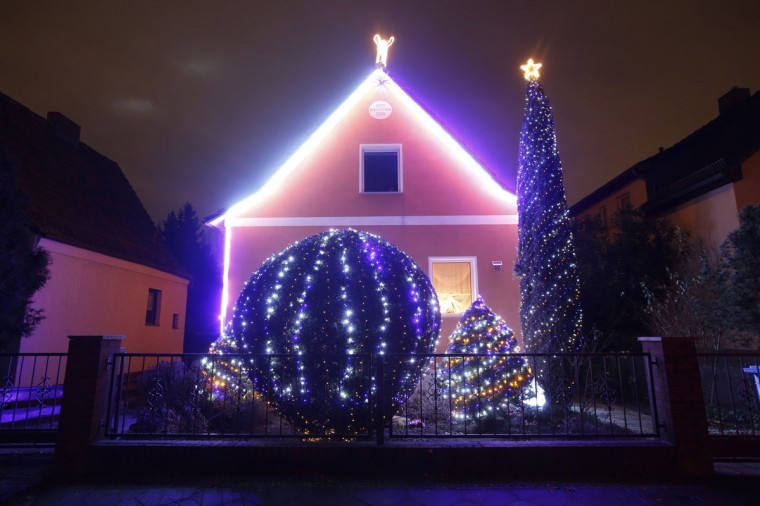 """A general view shows a so-called """"Lichterhaus"""" (light house) with Christmas decorations and lights in Berlin, December 10, 2014. Every year hundreds of houses across Germany are decorated by their owners with lights ahead of Christmas. (Fabrizio Bensch/Reuters)"""