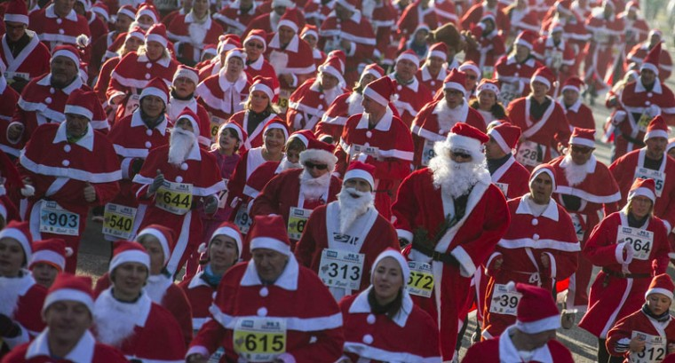 Runners dressed as Father Christmas start in the Nikolaus Lauf (Santa Claus Run) in the east German town of Michendorf, southwest of Berlin December 7, 2014. (Hannibal Hanschke/Reuters)