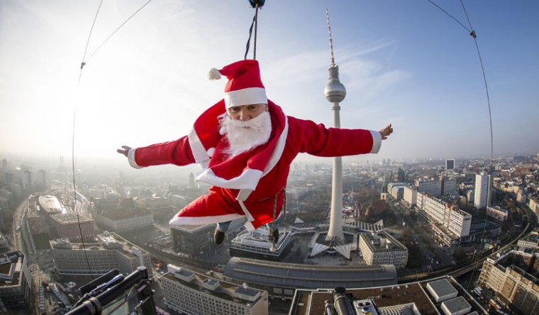 A man dressed as Santa Claus poses during a base flying event in downtown in Berlin December 6, 2014. Participants of the event hosted by entertainment agency Jochen Schweizer flew down 98 meters (322 ft.) from atop the hotel in the German capital. (Hannibal Hanschke/Reuters)