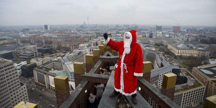 A man dressed as a Santa Claus poses on the roof of the Kollhoff Tower at Potsdamer Platz square in Berlin, December 14, 2014. (Hannibal Hanschke/Reuters)