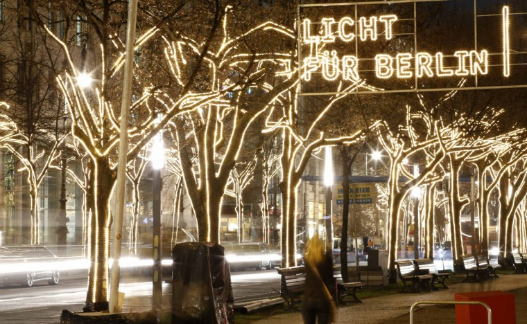 Trees illuminated by Christmas lights are pictured on Unter den Linden street near the Brandenburg Gate in Berlin, December 9, 2014. (Fabrizio Bensch/Reuters)